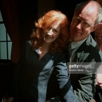 Bonnie Raitt and John Lithgow pose at the Agassiz Theatre on the Harvard Campus in Cambridge, Mass. Raitt received the third annual Harvard Arts Medal - May 2, 1997  © Dominic Chavez /The Boston Globe via Getty Images