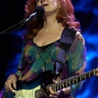 Bonnie Raitt performs to a sold-out crowd on Feb. 16, 2006, at the Dodge Theater in Phoenix  © Tom Hood /AP