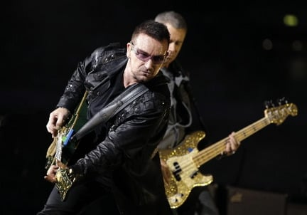 U2 will headline the second of two Rock and Roll Hall of Fame 25th anniversary concerts booked for Thursday and Friday, Oct. 29-30, at Madison Square Garden in New York. Shown here onstage in London in August are Bono, left, and bass player Adam Clayton. © Joel Ryan, Associated Press