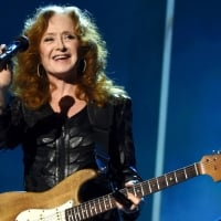 Musician Bonnie Raitt performs onstage at the 25th anniversary MusiCares 2015 Person Of The Year Gala honoring Bob Dylan at the Los Angeles Convention Center on February 6, 2015 in Los Angeles, California  © Larry Busacca/Getty Images for NARAS