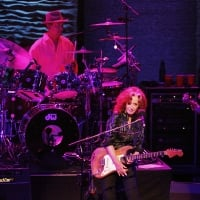 "Bonnie Raitt (center) is accompanied on tour by Ricky Fataar (left) on drums and James ""Hutch"" Hutchinson on the electric bass guitar as she performs at the Verizon Theater in Grand Prairie on Saturday night, September 29, 2012.  © Stewart F. House /Special Contributor"