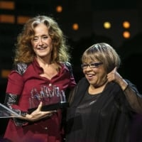 Bonnie Raitt receives her award from Mavis Staples during the Austin City Limits Hall of Fame Induction and Celebration held at ACL Live at the Moody Theatre, in Austin, Tx., on Wednesday, Oct. 12, 2016. Performers B.B. King, Bonnie Raitt and Kris Kristofferson, were inducted. (AUSTIN AMERICAN-STATESMAN / RODOLFO GONZALEZ)
