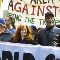 Bonnie Raitt marches down Market Street to a peace rally in February, flanked by her friends, actors Max Gail, left, and Danny Glover. Bonnie supports nonviolent disobedience, but disagrees with the tactics of those San Francisco protesters who blocked traffic in the city after the war began - February 17, 2003  © Scott Sommerdorf /San Francisco Chronicle/Corbis