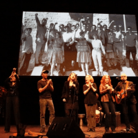 "The memorial ended with a rendition of ""Ain't Gonna Let Nobody Turn Me Around"" led by Bonnie Raitt, together with the members of the First AME Choir. Left to right: Me, Tom Morello, Barbara Williams, Holly Near, Bonnie Raitt & James McVay with the guitar."