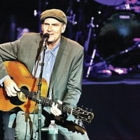 James Taylor performs in concert.