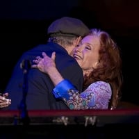 James Taylor and Bonnie Raitt embraced one another as Raitt walked on stage for her first performance since her surgery. © Alex Kormann /Star Tribune
