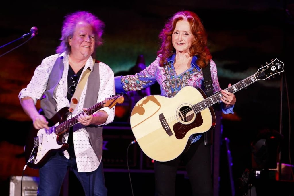James Taylor, a master, lets Bonnie Raitt 'steal the show every night'