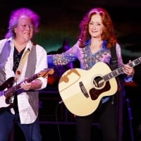 Bonnie Raitt laughed with guitarist George Marinelli during a performance Wednesday at Rupp Arena in Lexington 2-27-2019  © Alex Slitz aslitz@herald-leader.com